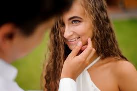 touching girl's face