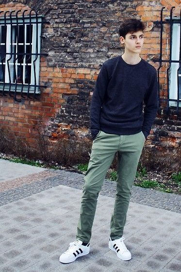 teen guy wearing chinos and sweater