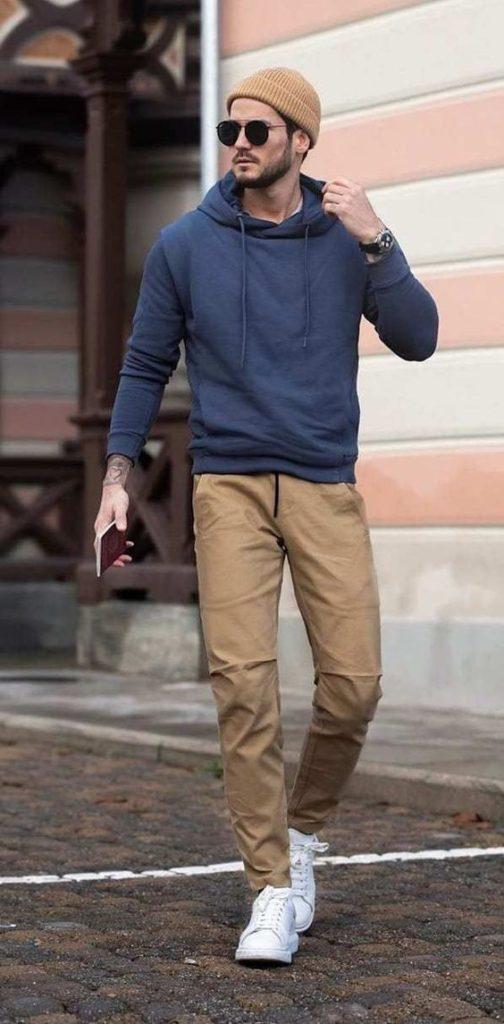 teen guy wearing chinos and hoodie
