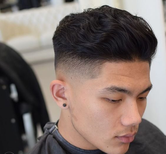 brushed back wavy hairstyle for guys